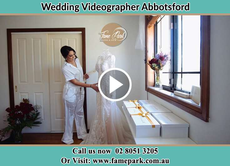 Bride looking at her wedding gown Abbotsford NSW 2046