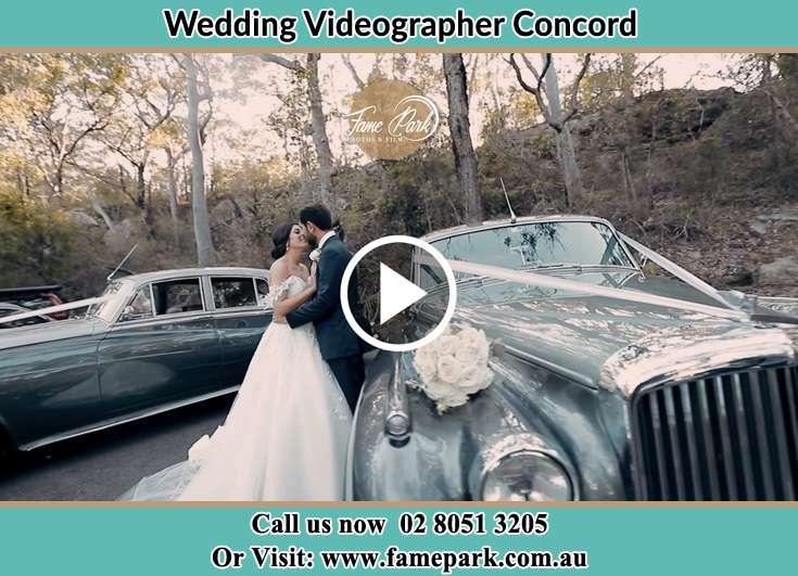 Bride and Groom kissed besides their bridal car Concord NSW 2137