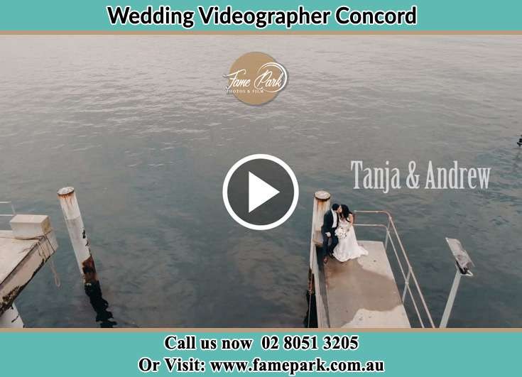 Bride and Groom kissed while sitting at the bay walk Concord NSW 2137