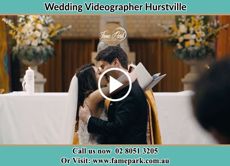 The newlyweds kissing after the rites Hurstville NSW 2220