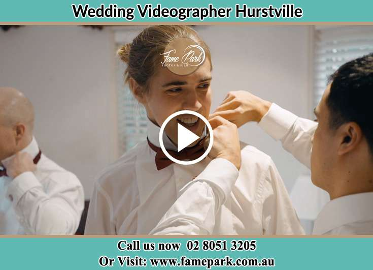 A groomsman fixing the Groom's tie Hurstville NSW 2220