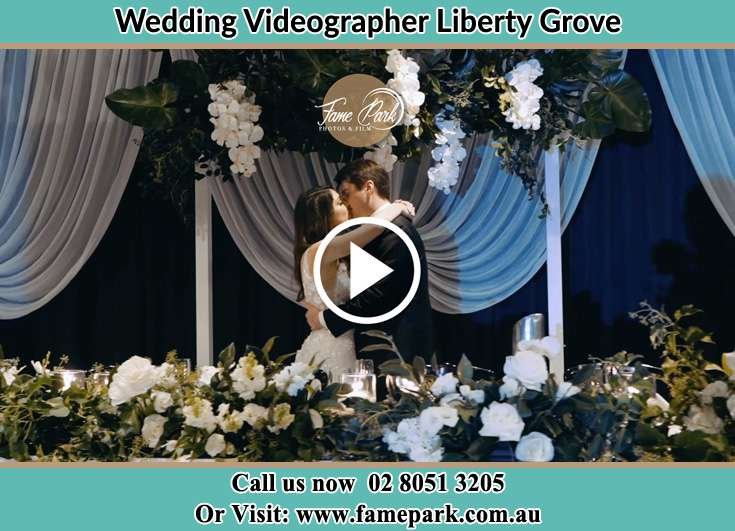 The newlyweds kissing Liberty Grove NSW 2138