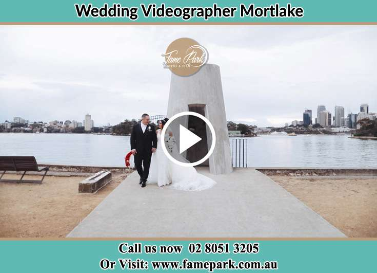 The new couple walking away from the shore Mortlake NSW 2137