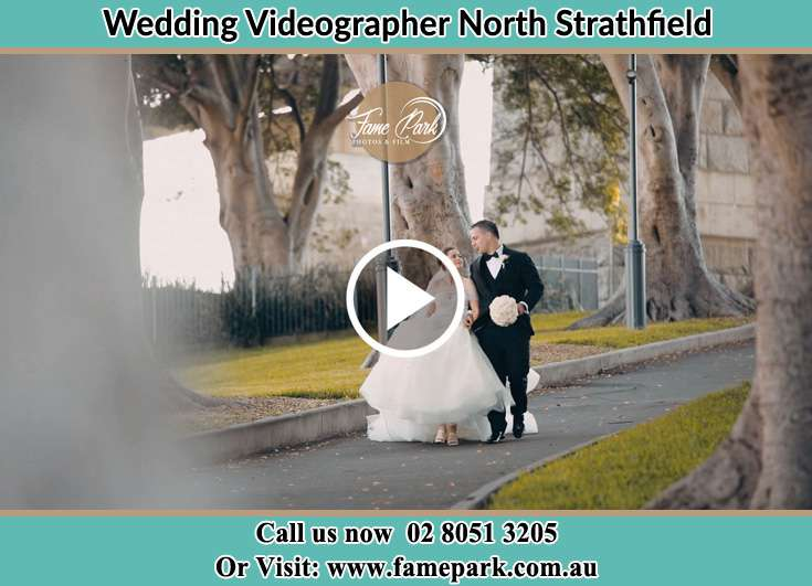 The Groom and the Bride walking in the park North Strathfield NSW 2137