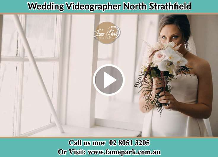 The Bride smells the bouquet of flowers North Strathfield NSW 2137