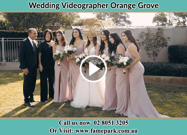 The Bride, her family and the bridesmaids pose for the camera Orange Grove 2380