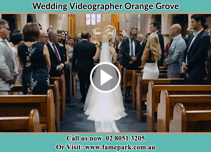 The Bride walking down the aisle with her father Orange Grove 2380